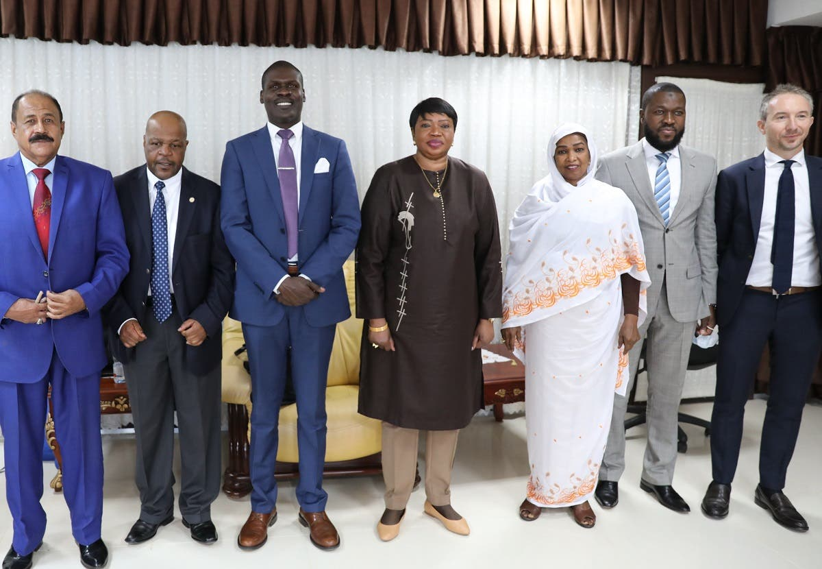 Prosecutor of the International Criminal Court, Fatou Bensouda (C) poses with Sudanese officials, including Minister of Justice Nasruddin Abdel Bari (3rd L), during her visit to the ministry of justice in Khartoum on October 18, 2020. (AFP)