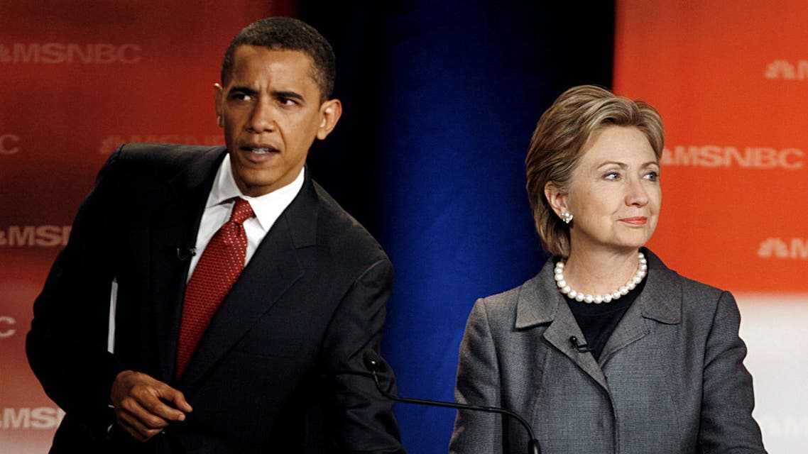 Obama and Clinton wait before the South Carolina Democratic party's presidential candidates debate at South Carolina State University in Orangeburg. (Reuters)