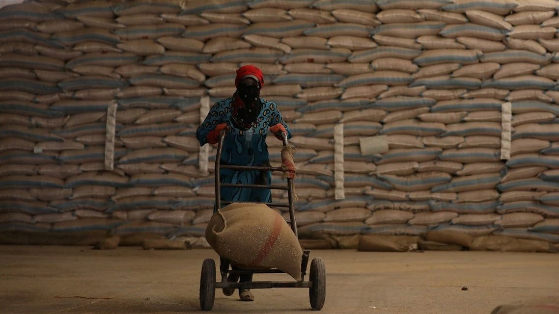 A woman pushes a cart loaded with a sack of wheat in Qamishli, Syria September 18, 2017. (Reuters)
