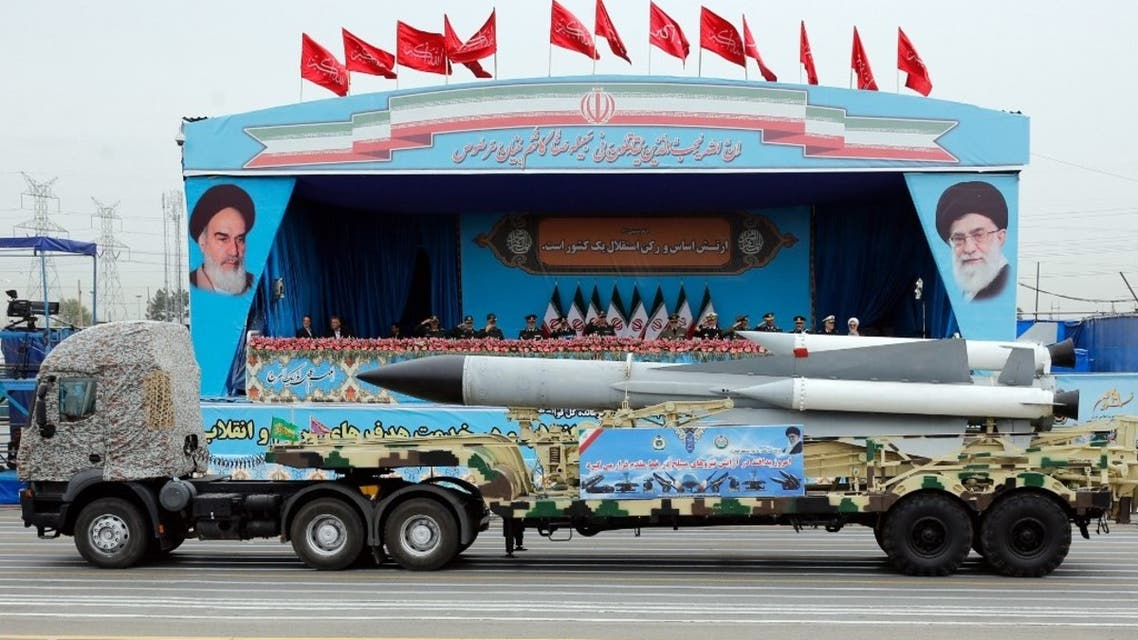 A Iranian military truck carrying a missile drives in front of the officials' stand during a military parade marking the annual National Army Day in Tehran, on April 18, 2019. (AFP)