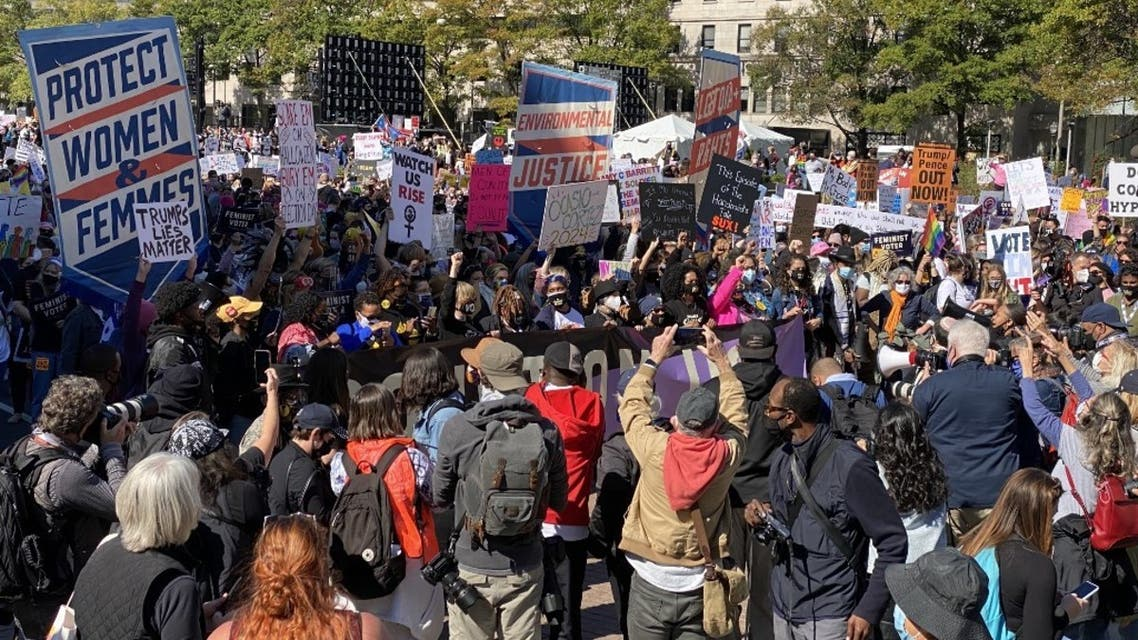 Demonstrators gather to take part in the nationwide Women's March on October 17, 2020, at Freedom Plaza in Washington, DC. (AFP)