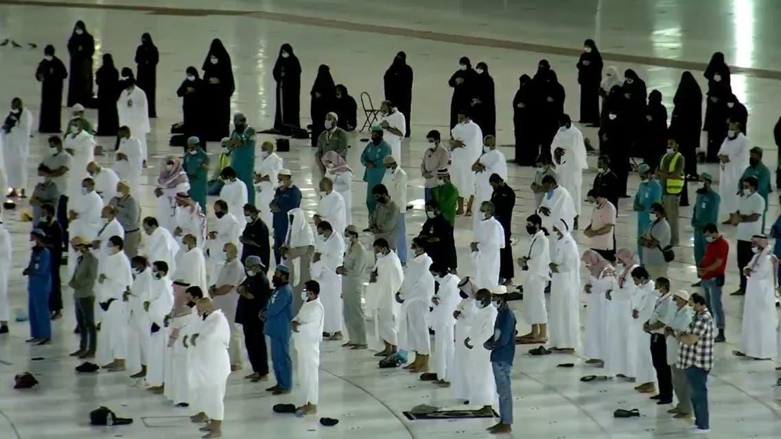 Group of worshipers pray Fajr (the dawn prayer) in front of the Holy Kaaba, Islam's holiest site, on October 18, 2020. (Screengrab/@alekhbariyatv)