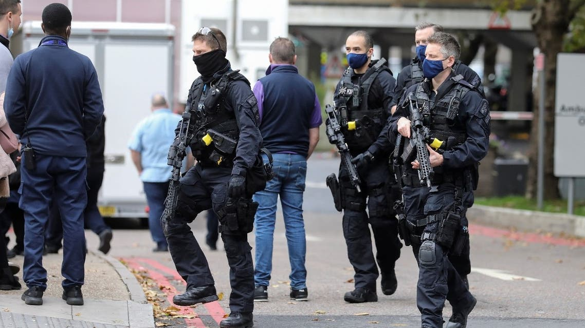 Police officers are seen at St Thomas' Hospital, in London, Britain October 13, 2020. (Reuters)