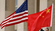 US charges 8 in secret plot to locate Chinese dissidents in America