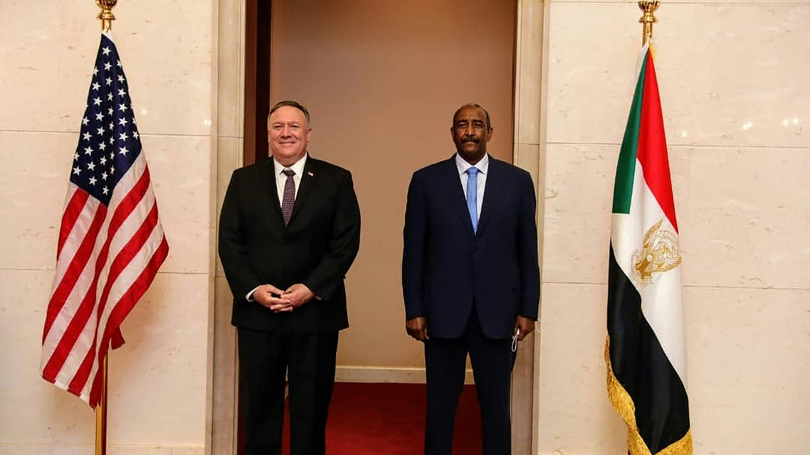A handout picture provided by Sudan's Foreign Media Council shows US Secretary of State Mike Pompeo (L) posing for a picture with Sudan's Sovereign Council chief General Abdel Fattah al-Burhan in Khartoum on August 25, 2020. Pompeo is on an official visit to Sudan to urge more Arab countries to normalise ties with Israel, following the US-brokered Israel-UAE agreement. He is the first American top diplomat to visit Sudan since Condoleezza Rice went in 2005.