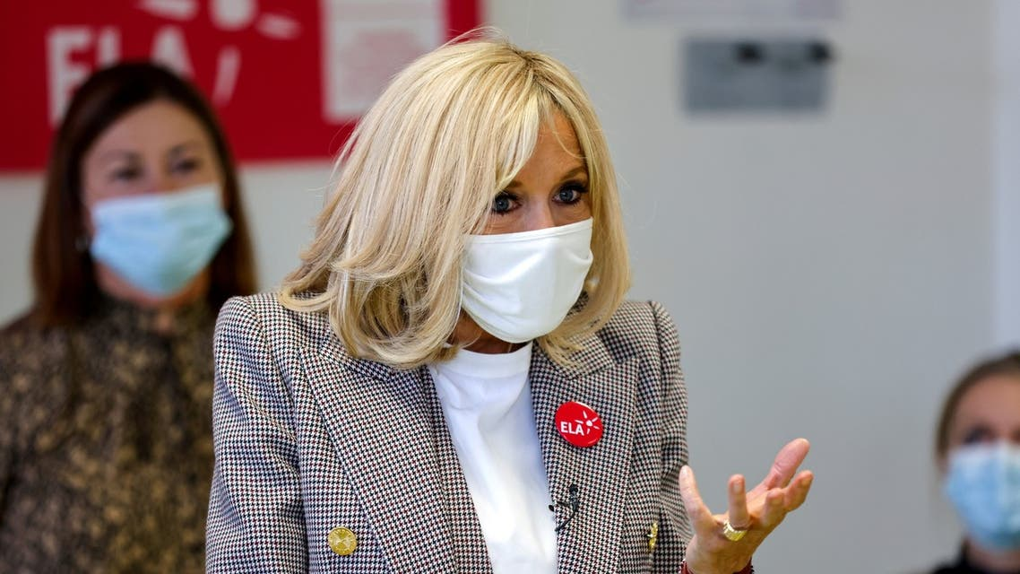 Brigitte Macron gives a dictation to school children in support for the European Leukodystrophy Association (ELA), at a school in Paris, France October 12, 2020. Thomas Coex/Pool via REUTERS