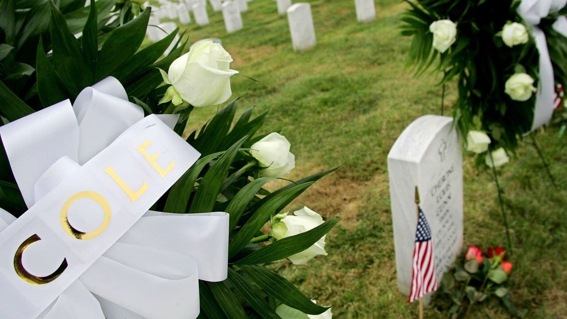 Wreaths are placed by the graves of sailors who died on the USS Cole at the Arlington National Cemetery in Virginia, Oct. 12, 2005. (Reuters)