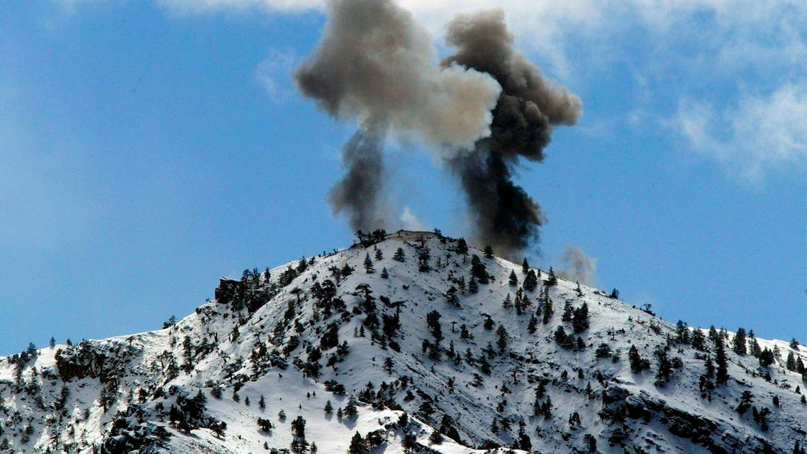 Smoke billows from the top of a mountain after airstrikes on a suspected enemy position by US Airforce B-52 bombers, March 10, 2002, near the villages of Sherkhankheyl, Marzak and Bobelkiel, in Afghanistan. (Reuters)