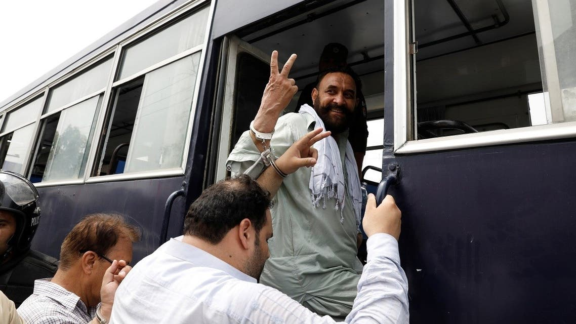 The supporters Pakistan Muslim League-Nawaz (PML-N) who were arrested after holding a rally to obstruct the arrest of Mohammad Safdar, the son-in-law of ousted Prime Minister Nawaz Sharif, gesture from a prison van in Rawalpindi, Pakistan. (Reuters)