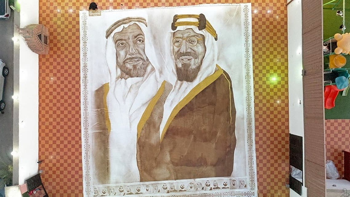 A handout picture released by the Guinness World Records on October 18, 2020 shows the world's largest coffee painting by Saudi artist Ohud Abdullah Almalki. (AFP/Guinness World Records)