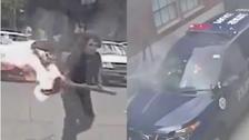 شاهد رجلا ينقضّ بنار مشتعلة على ضابط أميركي في السيارة