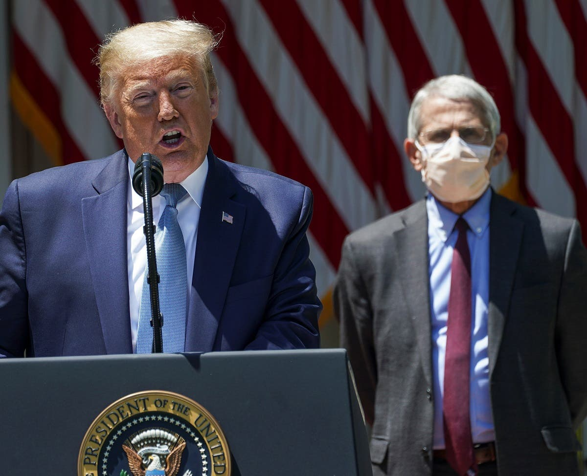 US President Donald Trump speaks as National Institute of Allergy and Infectious Diseases Director Dr. Anthony Fauci listens at the White House, May 15, 2020. (File photo: Reuters)