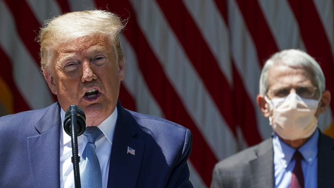 US President Donald Trump speaks as National Institute of Allergy and Infectious Diseases Director Dr. Anthony Fauci listens at the White House, May 15, 2020. (Reuters)