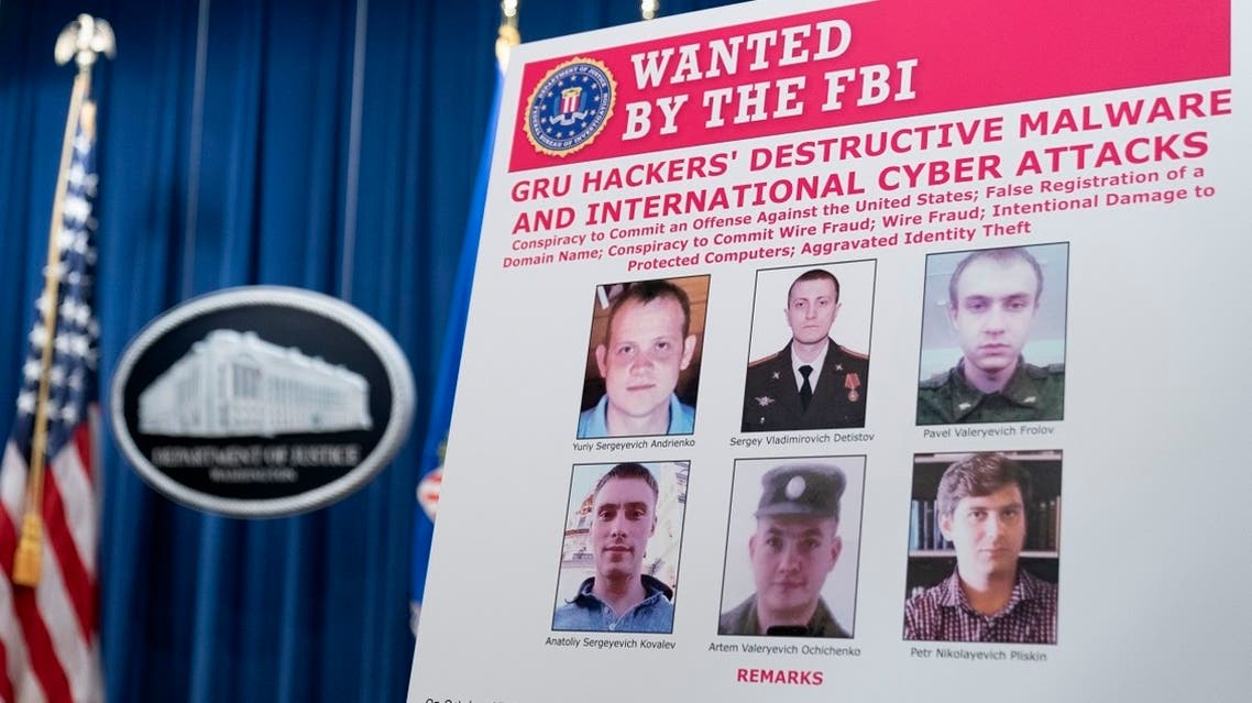 A poster showing six wanted Russian military intelligence officers is displayed before a news conference at the Department of Justice, Oct. 19, 2020, in Washington. (AP)