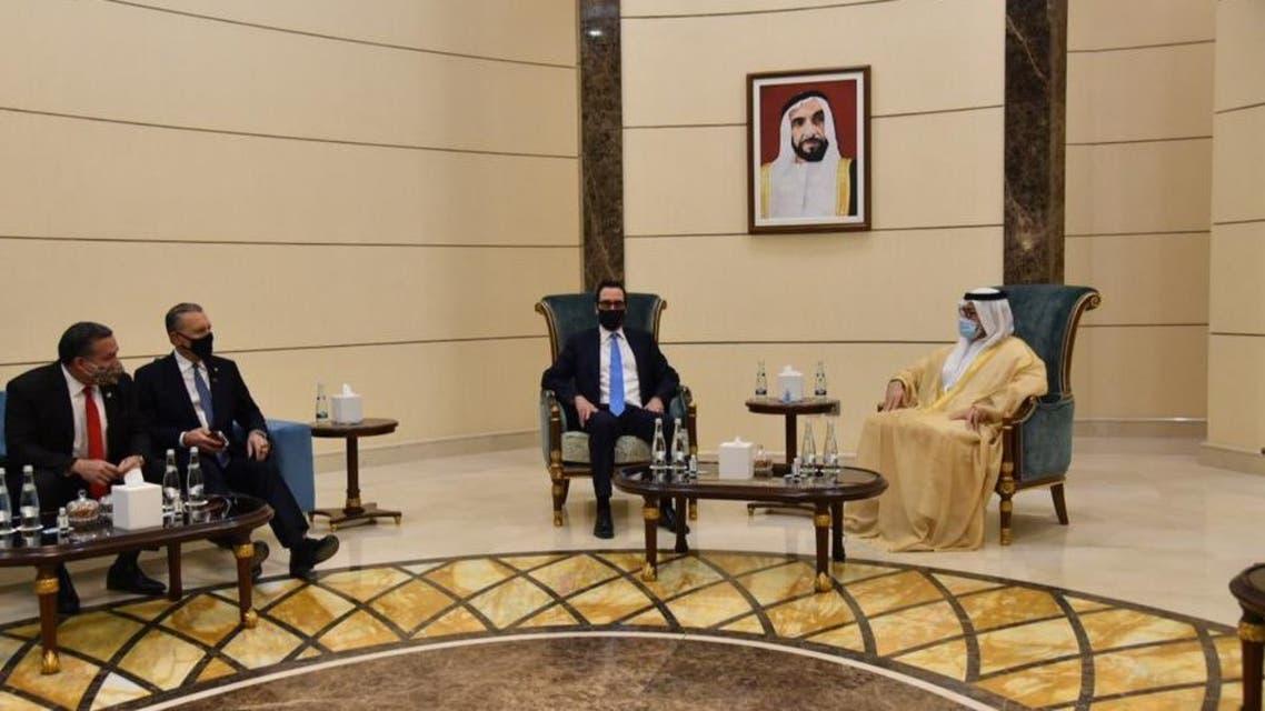 US Treasury Secretary Steven Mnuchin, second right, with Chairman of Abu Dhabi's Economic Development ohammed Ali Al Shorafa, far right, and US Ambassador to the UAE John Rakolta Jr., second left. (Twitter)