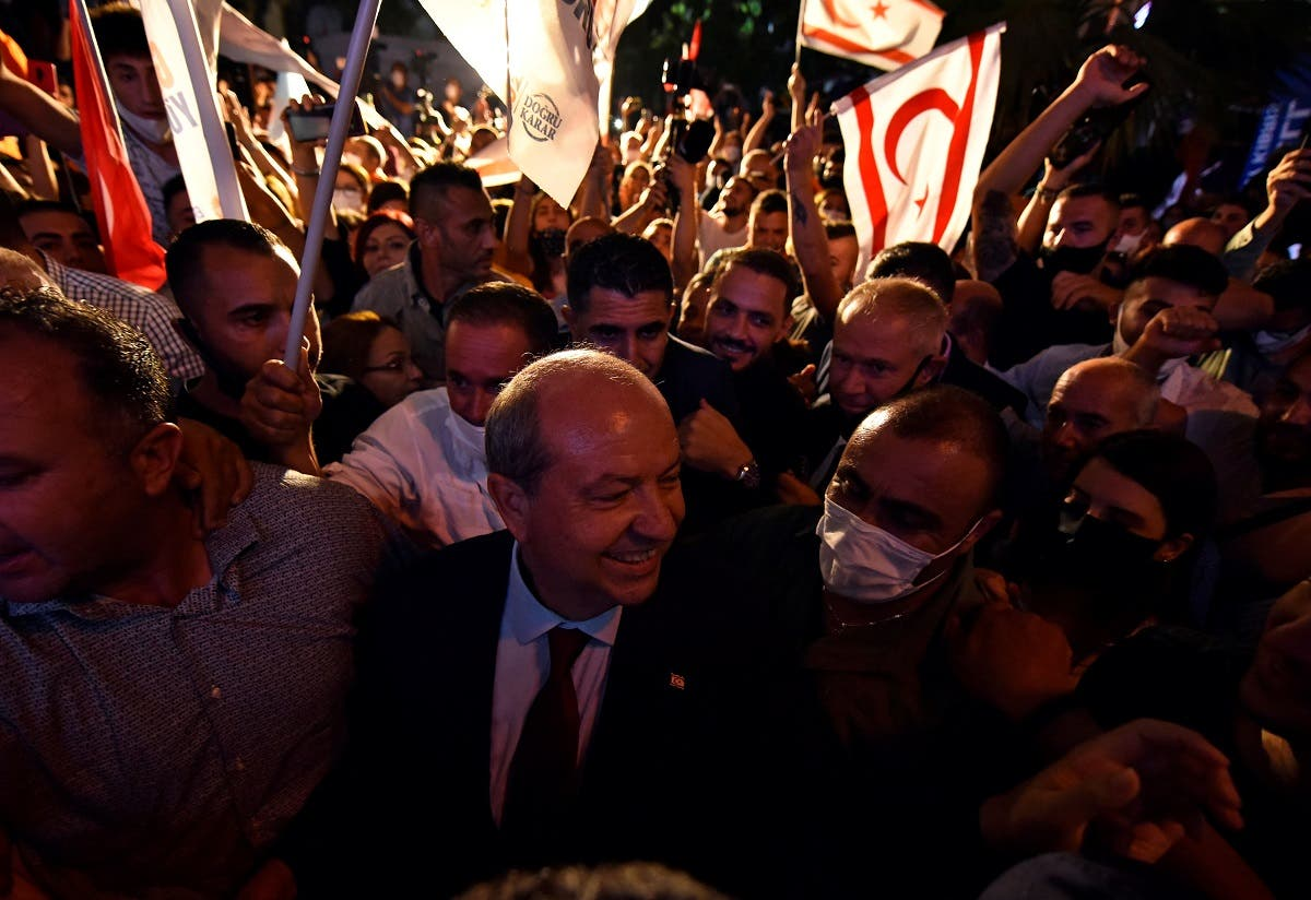 Turkish Cypriot politician Ersin Tatar celebrates his election victory in Turkish-controlled northern Nicosia, Cyprus October 18, 2020. (Reuters)