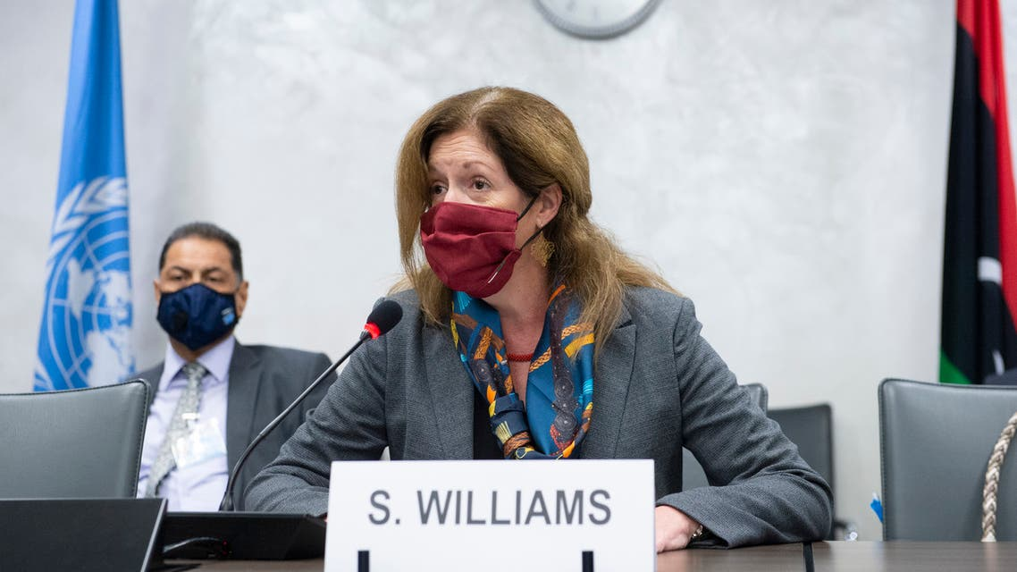This handout picture distributed by the United Nations Office at Geneva shows Deputy Special Representative of the UN Secretary-General for Political Affairs in Libya Stephanie Williams wearing a face mask during talks between the rival factions in the Libya conflict, as they resume on October 19, 2020, in Geneva. Talks between the rival factions in the Libya conflict resumed in Geneva on October 19, the UN said, as the 5+5 Joint Military Commission (JMC) met for the fourth time.