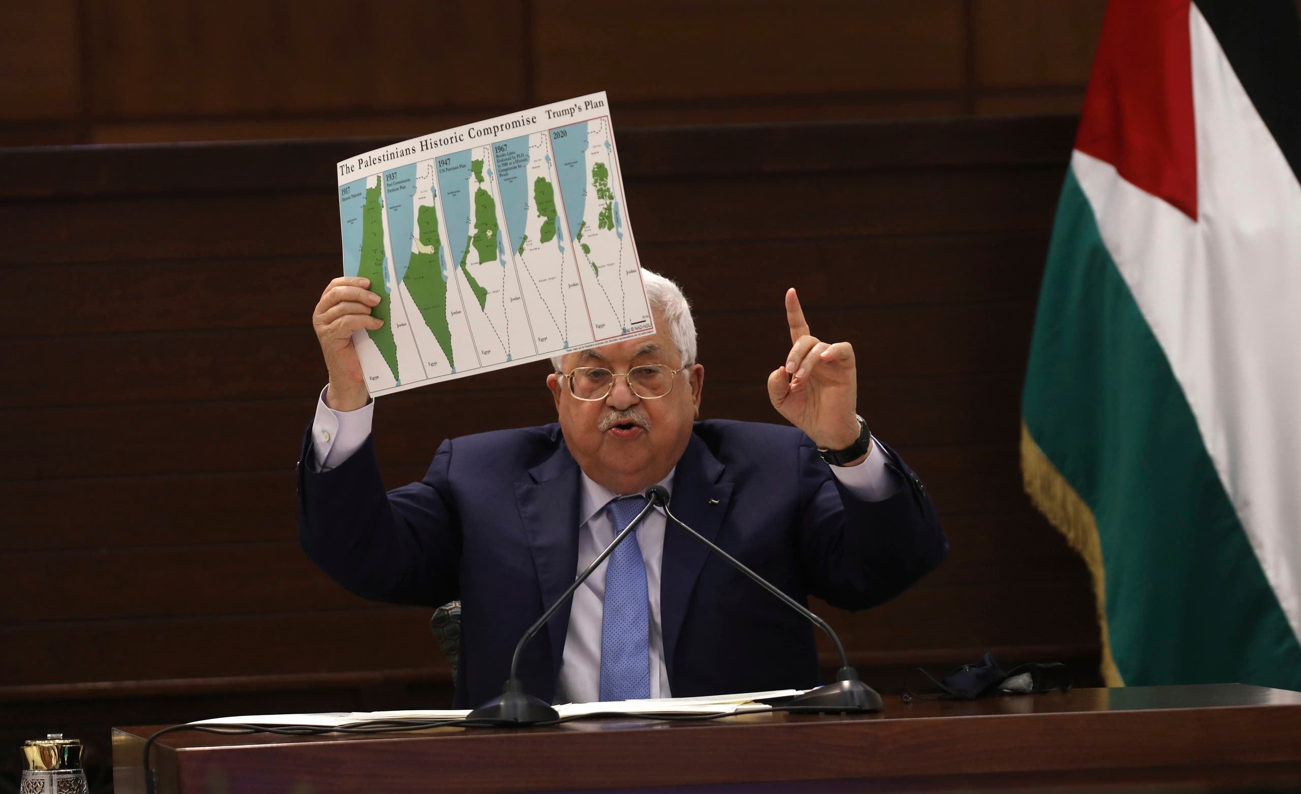 President Mahmoud Abbas holds up a chart during a leadership meeting at his headquarters, in the West Bank city of Ramallah on Sept. 3, 2020. (AP)
