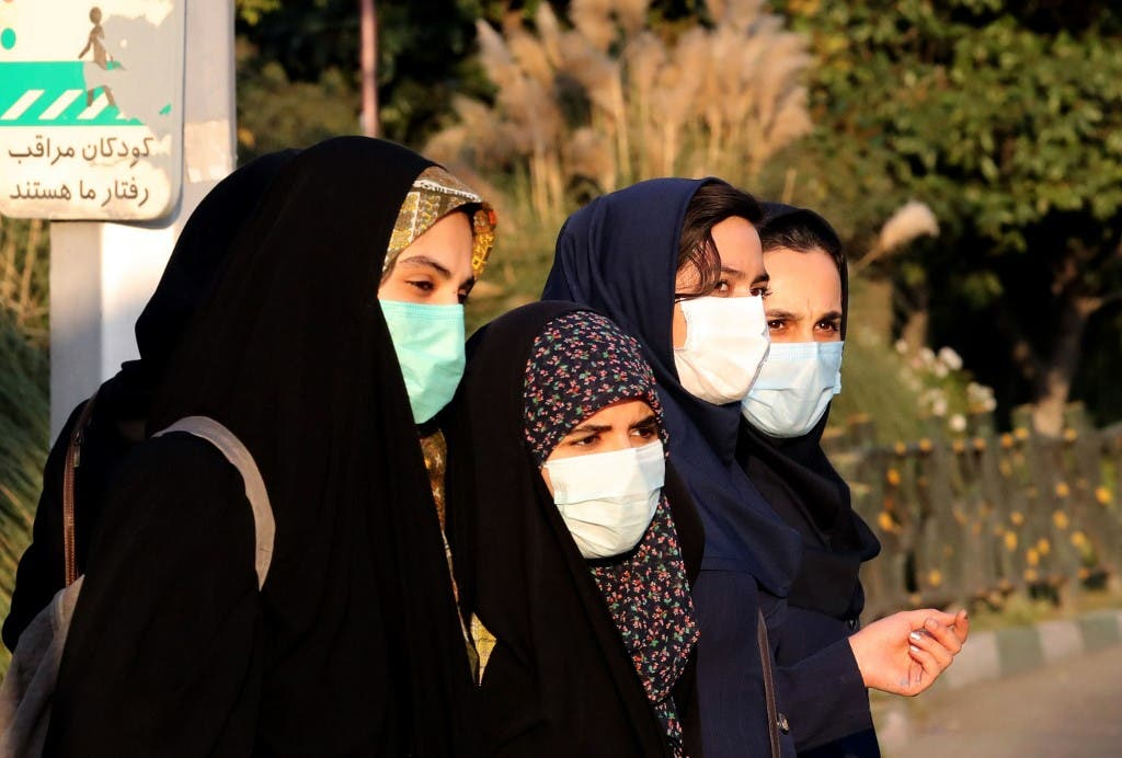 Iranian women wear face masks as a Covid-19 coronavirus pandemic precaution, in Iran's capital Tehran on October 19, 2020. (AFP)