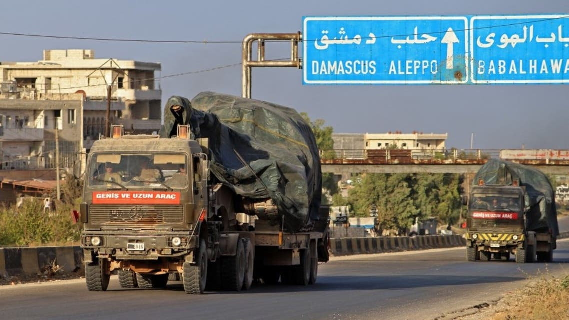 Turkish military vehicles, part of a convoy, drive through the town of Ariha in the rebel-held northwestern Idlib province on October 20, 2020, after vacating the Morek post in Hama's countryside. (AFP)