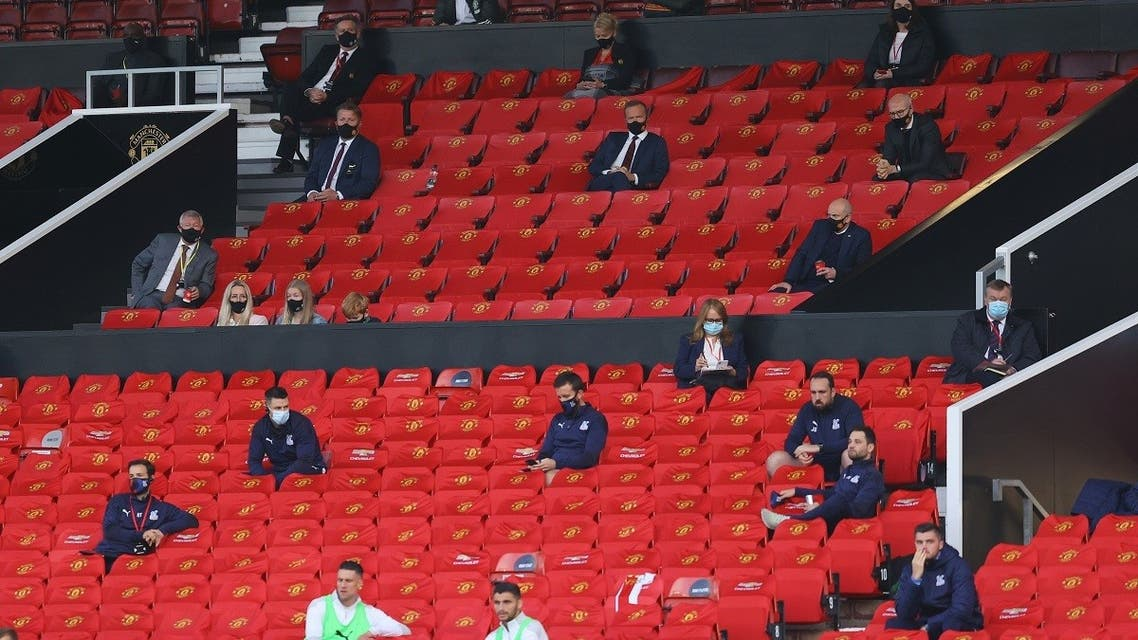 Sir Alex Ferguson and executive vice chairman Ed Woodward wearing protective face masks in the stands during the match. (Pool via Reuters/Richard Heathcote)