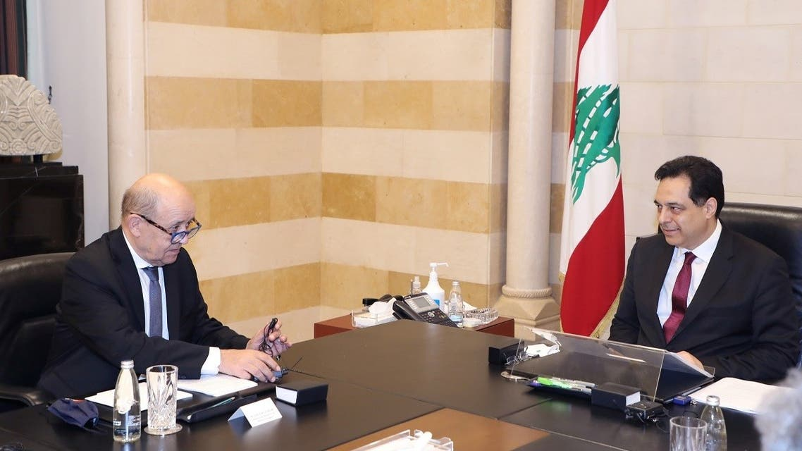 Lebanon's PM Hassan Diab meets with French Foreign Affair Minister Jean-Yves Le Drian at the governmental palace in Beirut, July 23, 2020. (Reuters)
