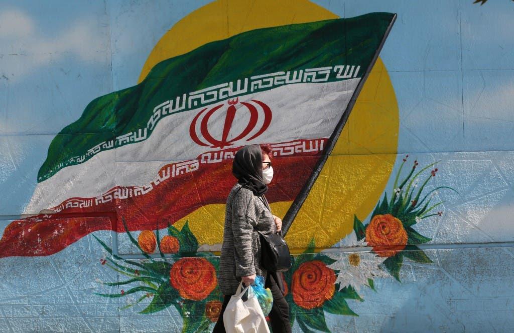 An Iranian woman wears a face mask as a COVID-19 coronavirus pandemic precaution, in Iran's capital Tehran on October 14, 2020. (AFP)