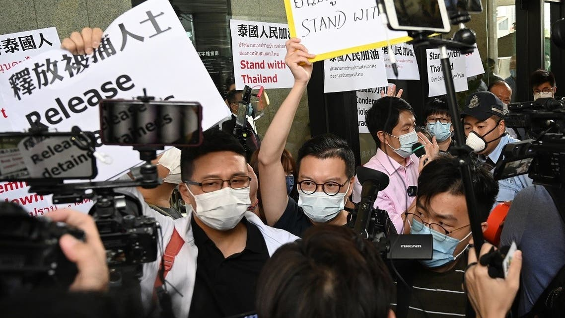 Activists demonstrate in solidarity with ongoing pro-democracy protests in Thailand, outside the office building where the Thai consulate is located in Hong Kong on October 19, 2020. (AFP)