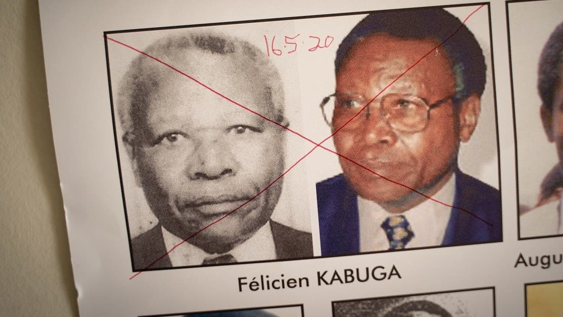 A file photo shows the date of arrest and a red cross are seen written on the face of Felicien Kabuga on a wanted poster at the Genocide Fugitive Tracking Unit office in Kigali, Rwanda, on May 19, 2020. (AFP/Simon Wohlfahrt)