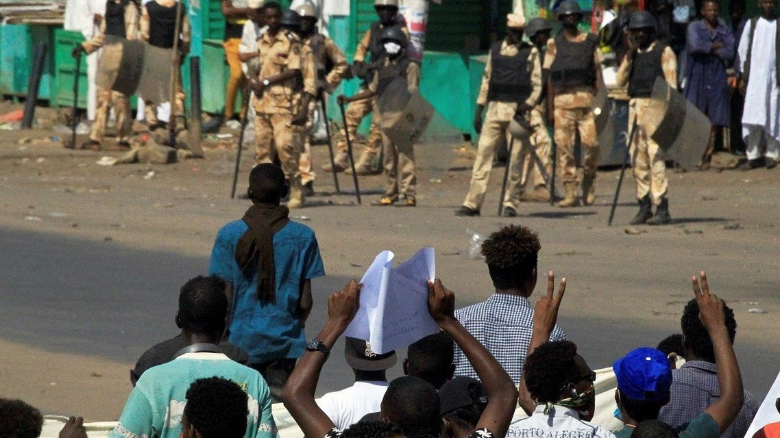 Sudanese protesters gather near riot police officers ahead of a rally to put pressure on the government to improve conditions and push ahead with reform in Khartoum, Sudan, on October 21, 2020. (Reuters)