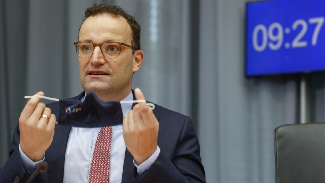 German Health Minister Jens Spahn takes off his face mask as he takes his seat prior to a meeting of the Franco-German Parliamentary Assembly on September 22, 2020 in Berlin. (AFP)