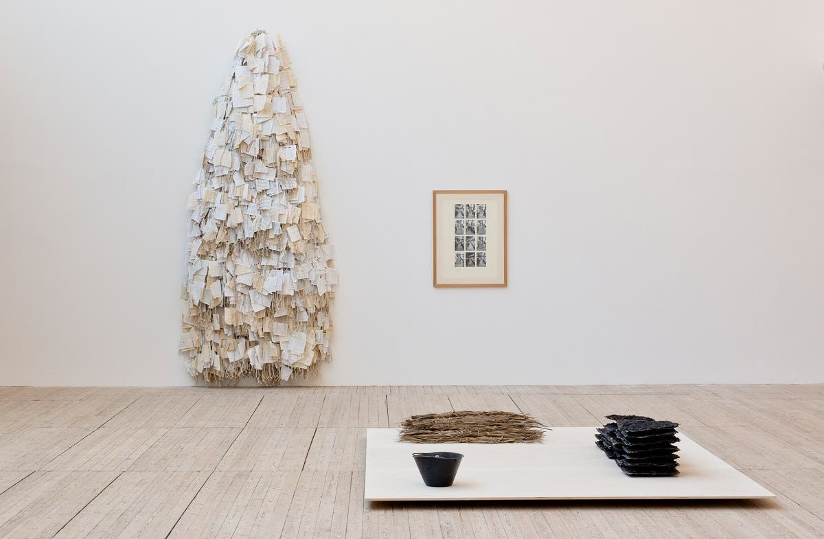 Dictionary. 1981.Photographs and pencil on mounting board and glue, dictionary pages and cotton rope. Installation view: Hassan Sharif: I Am The Single Work Artist, Malmö Konsthall, 2020. (Sharjah Art Foundation Collection. Photo: Helene Toresdotter)