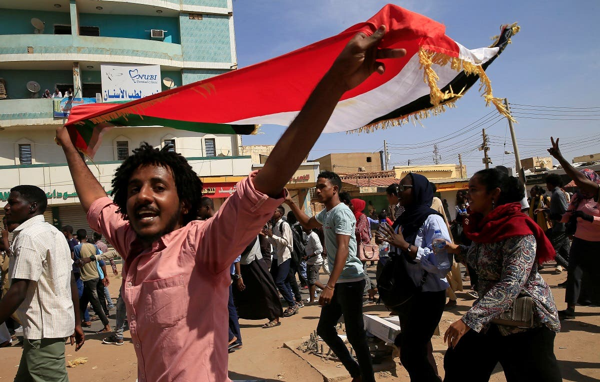 2020One of Sudanese protesters carries the national flag as they gather ahead of a rally to put pressure on the government to improve conditions and push ahead with reform in Khartoum, Sudan, on October 21, 2020. (Reuters)