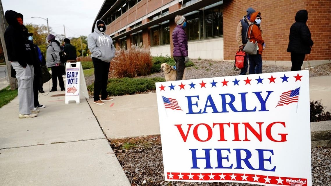 Voters line up in Milwaukee, on the first day of early voting in Wisconsin Oct. 20, 2020. (Reuters)