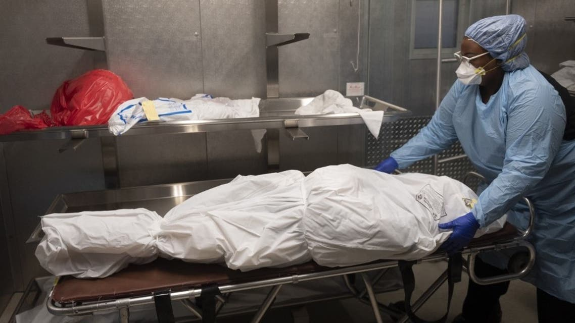 Transporter Morgan Dean-McMillan prepares the body of a COVID-19 victim at a morgue in Montgomery county, Maryland on April 17, 2020. (AFP)
