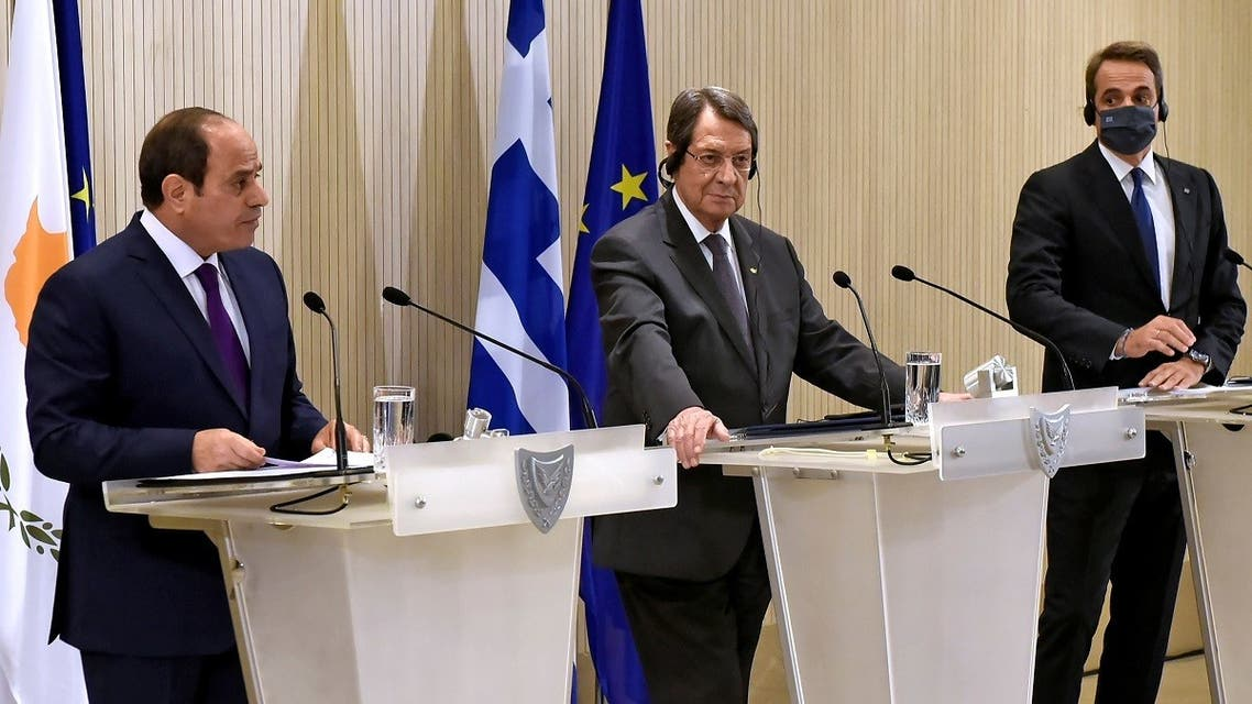 Cypriot President Anastasiades, Greek PM Mitsotakis and Egypt's President al-Sisi are seen during a news conference after a trilateral summit at the Presidential Palace in Nicosia, Cyprus October 21, 2020. (Iakovos Hatzistavrou/Pool via Reuters)