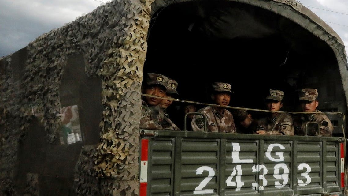 Chinese soldiers of the People's Liberation Army (PLA) sit on the back of a truck on the highway to Nyingchi, Tibet Autonomous Region, China, on October 19, 2020. (Reuters)