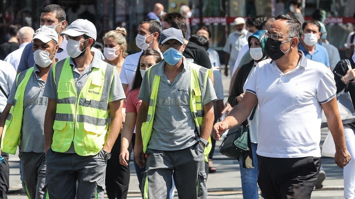 People wearing face masks walk in the street in Ankara, on September 7, 2020, amid the Covid-19 pandemic, caused by the novel coronavirus. (AFP/Adem Altan)