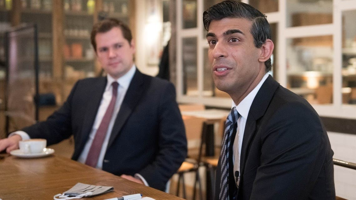 Britain's Chancellor of the Exchequer Rishi Sunak and Britain's Housing Secretary Robert Jenrick attend a roundtable for business representatives, amid the coronavirus disease (COVID-19) outbreak, at Franco Manca in Waterloo, London, Britain October 22, 2020. (Reuters)