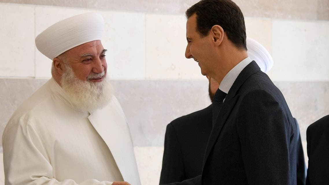 Syrian President Bashar al-Assad shaking hands with Mufti Adnan al-Afiouni during the inauguration of the center that is dedicated to counterterrorism and extremism, in Damascus. (File Photo: AFP)