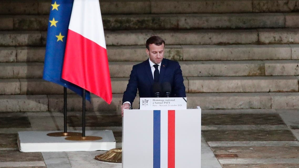 French President Emmanuel Macron delivers a speech in front of Samuel Paty's coffin (unseen) inside Sorbonne University's courtyard in Paris on October 21, 2020. (AFP)