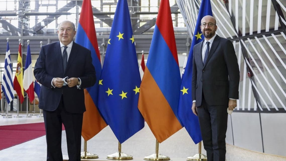 Armenian President Armen Sarkissian (L) poses with European Council President Charles Michel prior to a meeting in Brussels, on October 21, 2020. (AFP)