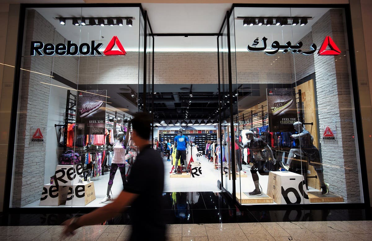 A man walks in front of the Reebok store at Bahrain City Center in Manama, Bahrain. (File photo: Reuters)