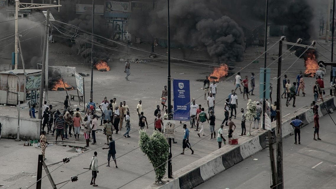 People are seen near burning tires on the street, in Lagos, Nigeria October 21, 2020, in this image obtained from social media. (Reuters)