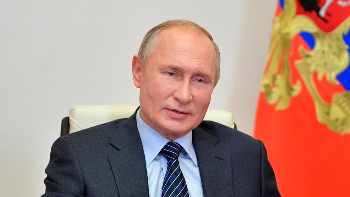 Russian President Vladimir Putin takes part in a video conference outside Moscow, Oct. 21, 2020. (AP)