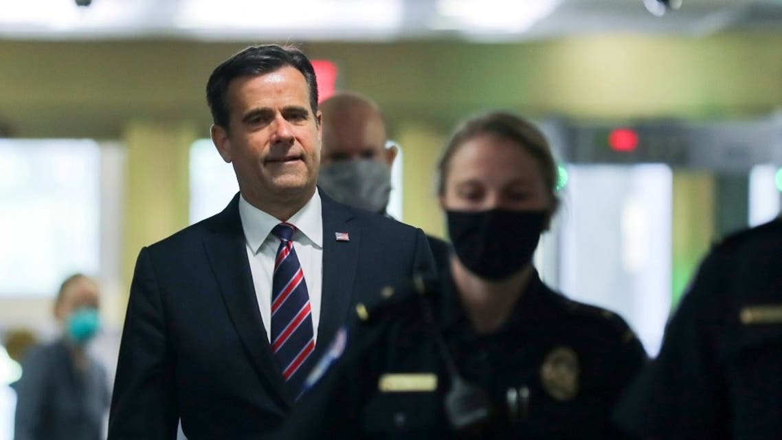 John Ratcliffe, Director of National Intelligence, is escorted by US Capitol police officers in Washington, May 5, 2020. (Reuters)