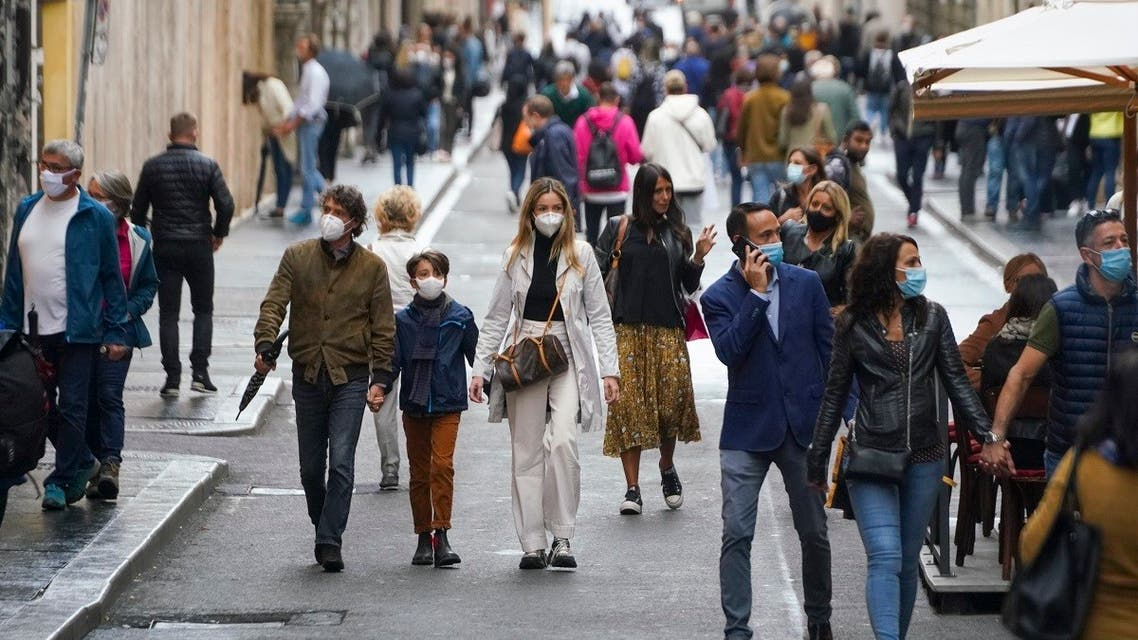 People wear face masks to prevent the spread of COVID-19 as they stroll in downtown Rome, Oct. 3, 2020. (AP)