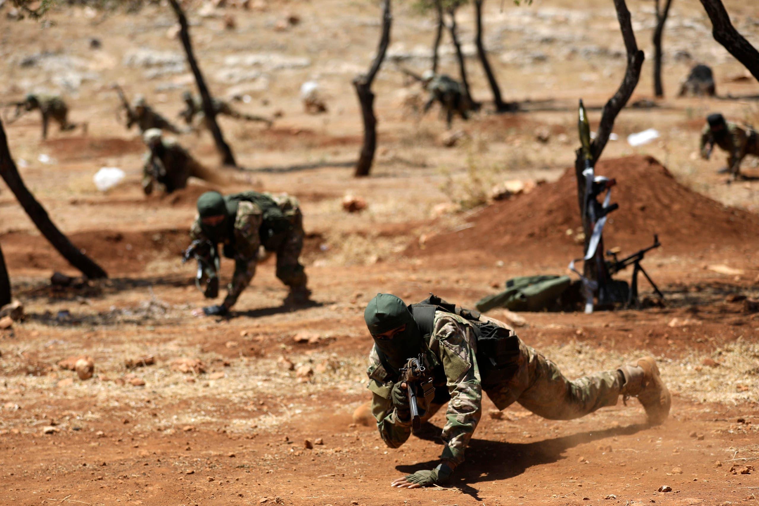"""تدريب عسكري لعناصر من """"هيئة تحرير الشام"""" (أرشيفية)"""