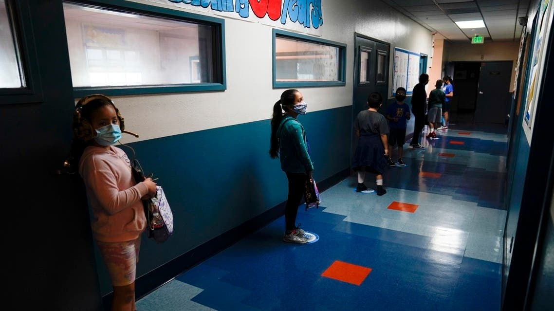 Los Angeles Unified School District students stand in a hallway socially distance during a lunch break at Boys & Girls Club of Hollywood in Los Angeles. (AP)