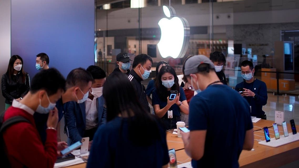 People look at Apple products at an Apple Store, as the coronavirus disease (COVID-19) outbreak continues in Shanghai China, on October 23, 2020. (Reuters)